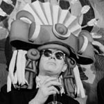 Andy wearing an Inca headdress with Salvador Dali at the St. Regis Hotel, NYC, winter, 1964-65