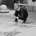 Andy spray paints the flower image, the Factory, NYC, spring 1965
