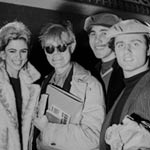 Edie Sedgwick, Andy, Chuck Wein and Gerard Malanga board a plane to Paris, NYC, May 1965
