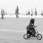 Girl on tricycle, Deauville, France